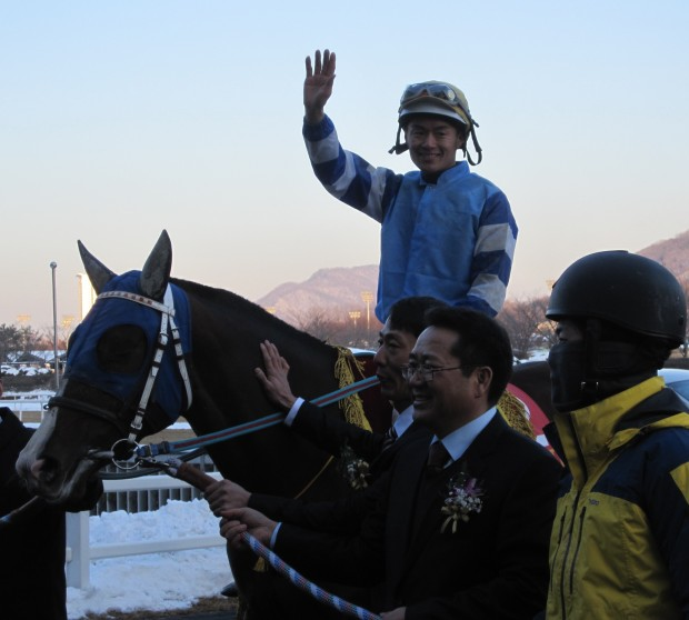 Gamdonguibada and Joe Fujii in the Grand Prix Winner's Circle