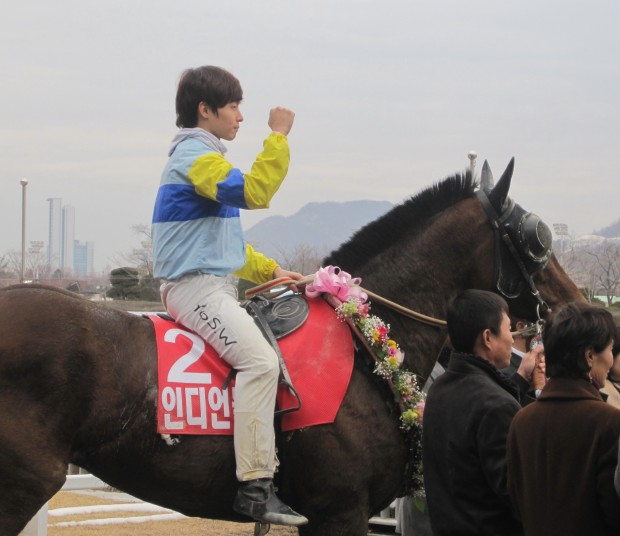 Indian Blue and Yoo Seung Wan, both in the Stakes winner's circle for the first time