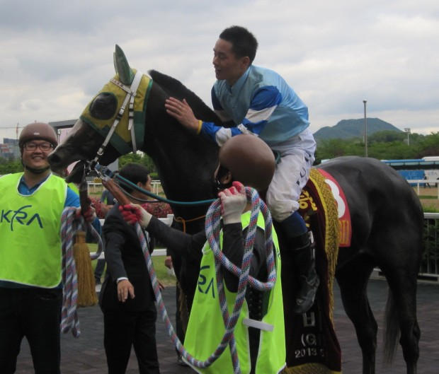 Speedy First and Joe Fujii in the Korean Derby Winner's Circle