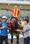 Trainer Lee Shin Young with Full Moon Party in the TJK Winner's Circle (Pic: Ross Holburt)