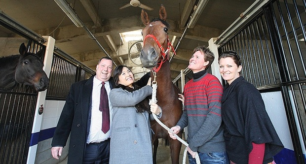 Joe Dallao (left) with his wife Young Sook at the Busan Racecourse stables with Bart and Pam Rice (Pic: Hankyoreh)